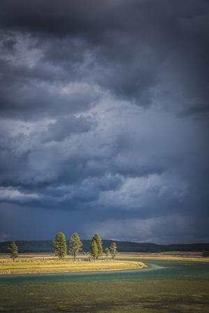 Sun Breaks Through An Afternoon Thunderstorm Over The Yellowstone River In The Hayden Valley