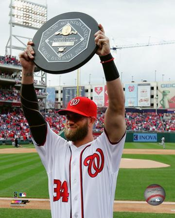 Bryce Harper holds up the 2015 MVP trophy