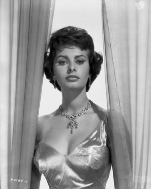 Sophia Loren wearing a Glossy Single Shoulder Dress in a Classic Portrait by Bud Fraker