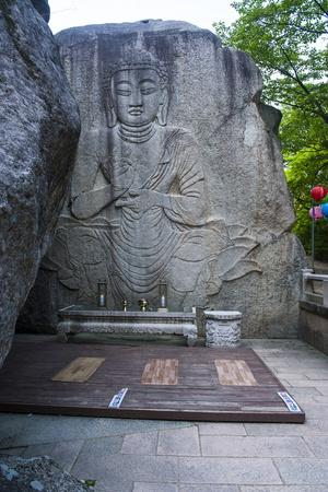 https://imgc.allpostersimages.com/img/posters/buddha-carved-in-a-rock-cliff-beopjusa-temple-complex-south-korea-asia_u-L-PQ8PMB0.jpg?p=0