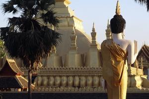 Buddha Statue and View of Wat That Luang Neua Pagoda, Vientiane (Viangchan), Laos, 20th Century