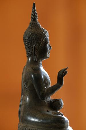 https://imgc.allpostersimages.com/img/posters/buddha-statue-in-profile-france_u-L-Q1GYGLE0.jpg?artPerspective=n
