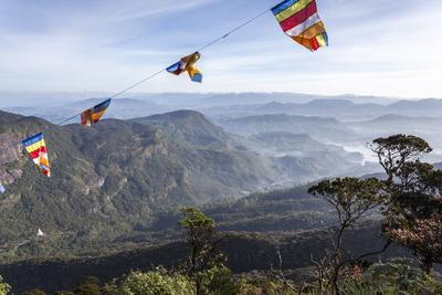 https://imgc.allpostersimages.com/img/posters/buddhist-flags-framing-the-view-into-the-dalhousie-and-hill-country-at-sunrise-from-adam-s-peak_u-L-PQ8QCB0.jpg?p=0