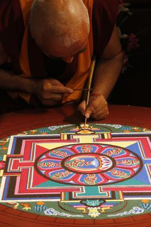 https://imgc.allpostersimages.com/img/posters/buddhist-sand-mandala-a-spiritual-and-ritual-symbol-representing-the-universe-france_u-L-Q1GYGOF0.jpg?artPerspective=n