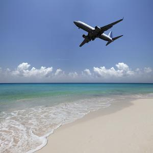 Airplane Flying over a Deserted Beach by Buena Vista Images