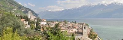 https://imgc.allpostersimages.com/img/posters/buildings-at-the-waterfront-with-snowcapped-mountain-in-the-background-gargnano-monte-baldo_u-L-PNVM5Q0.jpg?p=0