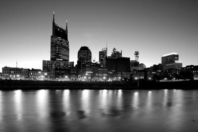 Buildings lit up at dusk at the waterfront, Cumberland River, Bell South Tower, Nashville, Tenne...