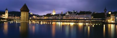 Buildings Lit Up at Dusk, Chapel Bridge, Reuss River, Lucerne, Switzerland