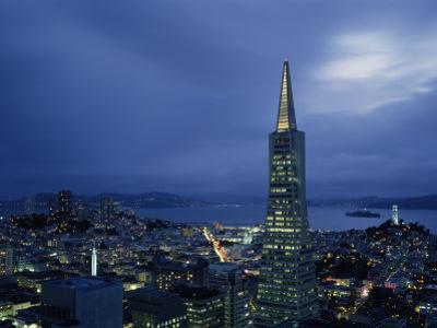 Buildings Lit Up at Dusk, Transamerica Pyramid, Coit Tower, San Francisco, California, USA
