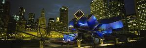 Buildings Lit Up at Night, Pritzker Pavilion, Millennium Park, Chicago, Illinois, USA