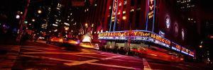 Buildings Lit Up at Night, Radio City Music Hall, Rockefeller Center, Manhattan, New York, USA