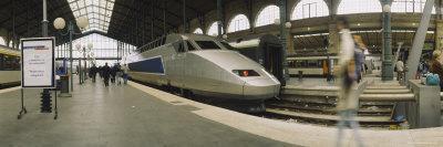 https://imgc.allpostersimages.com/img/posters/bullet-train-at-a-railroad-station-paris-france_u-L-P34LZM0.jpg?p=0