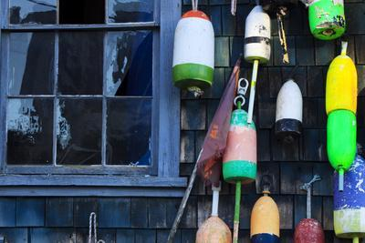 https://imgc.allpostersimages.com/img/posters/buoys-on-an-old-shed-at-bernard-maine-usa_u-L-PN71Y00.jpg?p=0