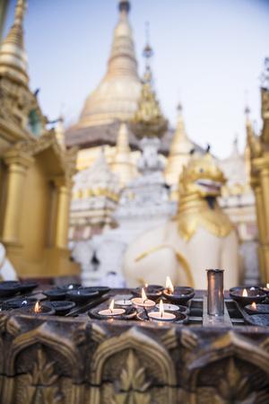 https://imgc.allpostersimages.com/img/posters/burning-candles-at-shwedagon-pagoda-shwedagon-zedi-daw-golden-pagoda-myanmar-burma_u-L-Q12SCMF0.jpg?p=0