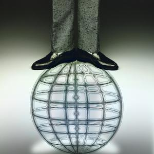 Businessman Standing on Globe