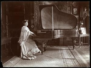 Mrs. I. M. Clark Seated at a Grand Piano, 1904 by Byron Company