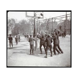 View of Boys Playing Basketball on a Court at Tompkins Square Park on Arbor Day, New York, 1904 by Byron Company