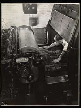 Working at a Meihle Press at Unz and Co., 24 Beaver Street, New York, 1932 by Byron Company