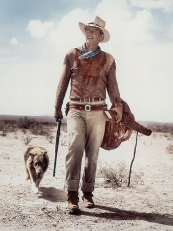 "ca., 1953 --- Actor John Wayne on the movie set of ""Hondo"" (Hondo, L'Homme du Desert), directed by"