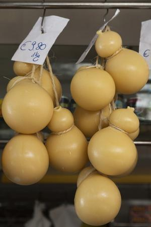 https://imgc.allpostersimages.com/img/posters/caciocavallo-cheese-for-sale-in-a-market-in-martina-franca-puglia-italy-europe_u-L-PQ8NFB0.jpg?p=0