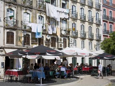 https://imgc.allpostersimages.com/img/posters/cafe-on-bacalhoeiros-street-in-the-alfama-district-lisbon-portugal-europe_u-L-PFNFN60.jpg?p=0