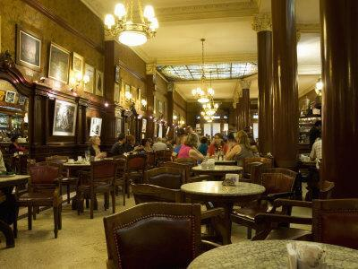 https://imgc.allpostersimages.com/img/posters/cafe-tortoni-a-famous-tango-cafe-restaurant-located-on-avenue-de-mayo-buenos-aires_u-L-P91WGF0.jpg?artPerspective=n