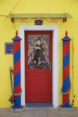Colourful, Ornate Traditional Doorway and Striped Mooring Posts in the Town of Burano, Venice by Cahir Davitt