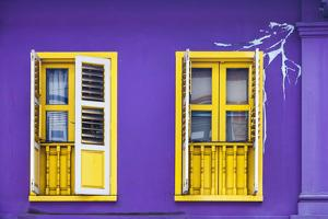 Colourful Purple Painted House and Yellow Window Detail on Tanjong Pagar Road, Singapore. by Cahir Davitt