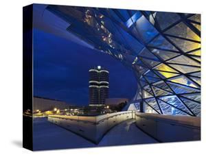 Twilight View of Pedestrian Bridge to BMW Headquarters Office Building and Museum, BMW by Cahir Davitt