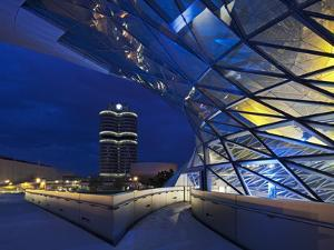 Twilight View of Pedestrian Bridge to BMW Headquarters Office Building and Museum, BMW by Cahir Davitt