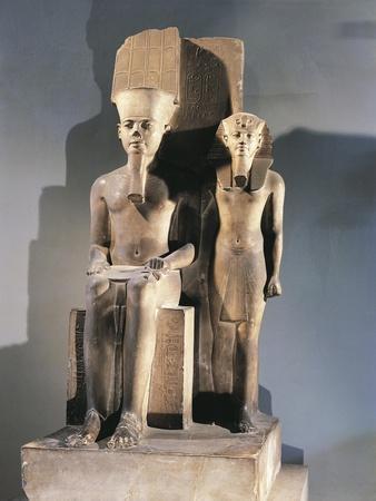 https://imgc.allpostersimages.com/img/posters/calcite-sculptural-group-portraying-pharaoh-tutankhamen-standing-beside-enthroned-god-amon_u-L-POPUEJ0.jpg?p=0