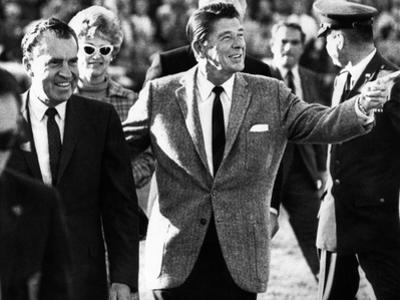 Calif Gov Ronald Reagan Escorts Pres-Elect Richard Nixon across Field at Halftime of Rose Bowl Game
