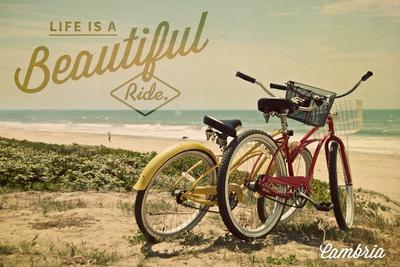 https://imgc.allpostersimages.com/img/posters/cambria-california-life-is-a-beautiful-ride-bikes_u-L-Q1GQM7L0.jpg?p=0