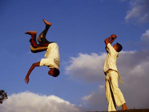 Two Boys Practice Capoeira, the Brazilian Martial Art by Camilla Watson