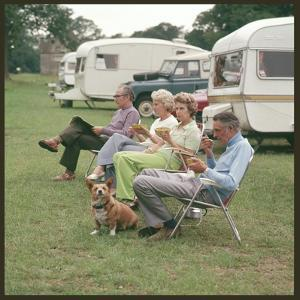Camping Couples and Corgi