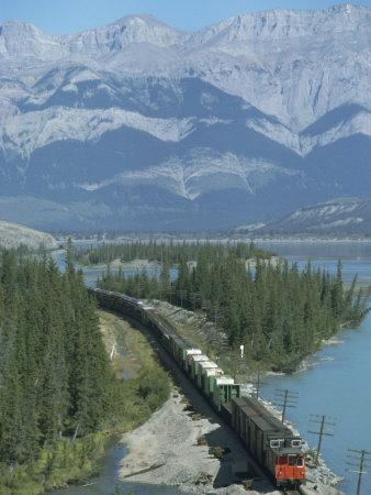 https://imgc.allpostersimages.com/img/posters/canadian-national-railways-goods-train-along-athabasca-river-jasper-national-park-rocky-mountains_u-L-P1JXLB0.jpg?p=0