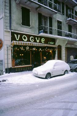 Car covered in snow in French street