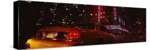 Car on a Road, Radio City Music Hall, Rockefeller Center, Manhattan, New York, USA