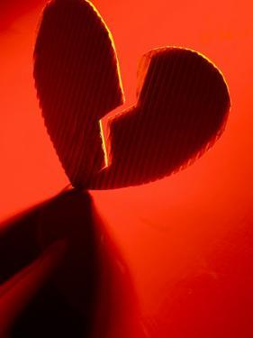 Cardboard Broken Heart in Red Light