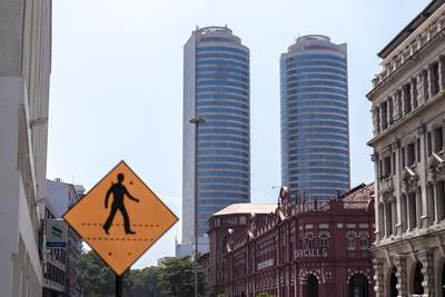 https://imgc.allpostersimages.com/img/posters/cargills-shopping-promenade-with-business-district-beyond-colombo-sri-lanka-asia_u-L-PQ8SLN0.jpg?p=0