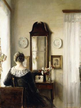 Interior with a Seated Woman by a Window by Carl Holsoe