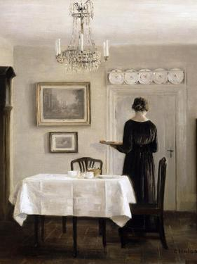 Interior with Lady Carrying Tray,C.1905 by Carl Holsoe