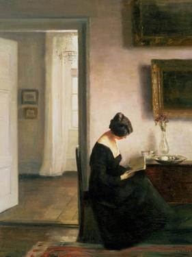 Woman Reading in an Interior by Carl Holsoe