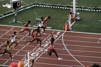 Carl Lewis Crosses the Finishing Line at the Los Angeles Olympics