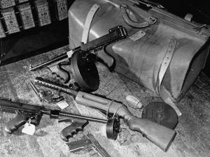 Arsenal of Machine Guns, Pistols, Shotguns Etc.- Belongs to Recently Captured Frank Dailey and Gang by Carl Mydans