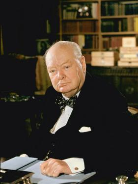 British Politician Sir Winston Churchill, Formal Portrait at Desk by Carl Mydans