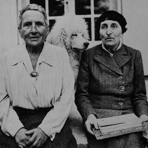 Lesbian Authors Gertrude Stein and Alice B. Toklas with their Poodle Basket II by Carl Mydans
