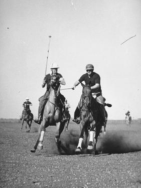 Men Playing Polo by Carl Mydans