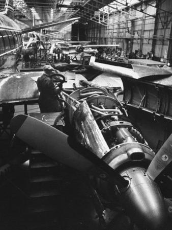 Men Working on Partially Completed Jets at New Vickers Plant by Carl Mydans