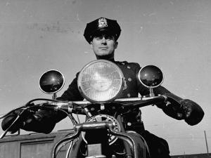 NYPD Motorcycle Cop Francis Kennedy Patrolling the Streets on His Bike by Carl Mydans